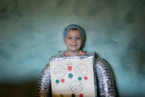 young boy in carboard and foil robot costume