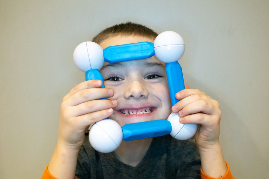 Boy Playing with Magnetic Building STEM Toy