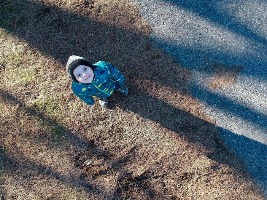 Young Boy watching drone quadcopter
