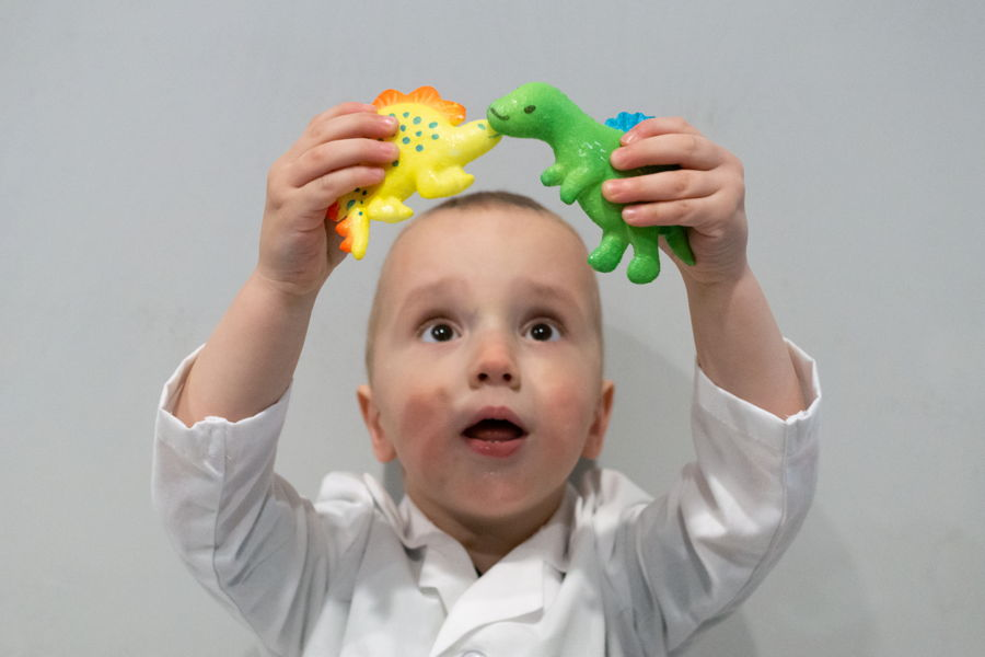 Young Boy Surprised at Growing Dinosaur Activity