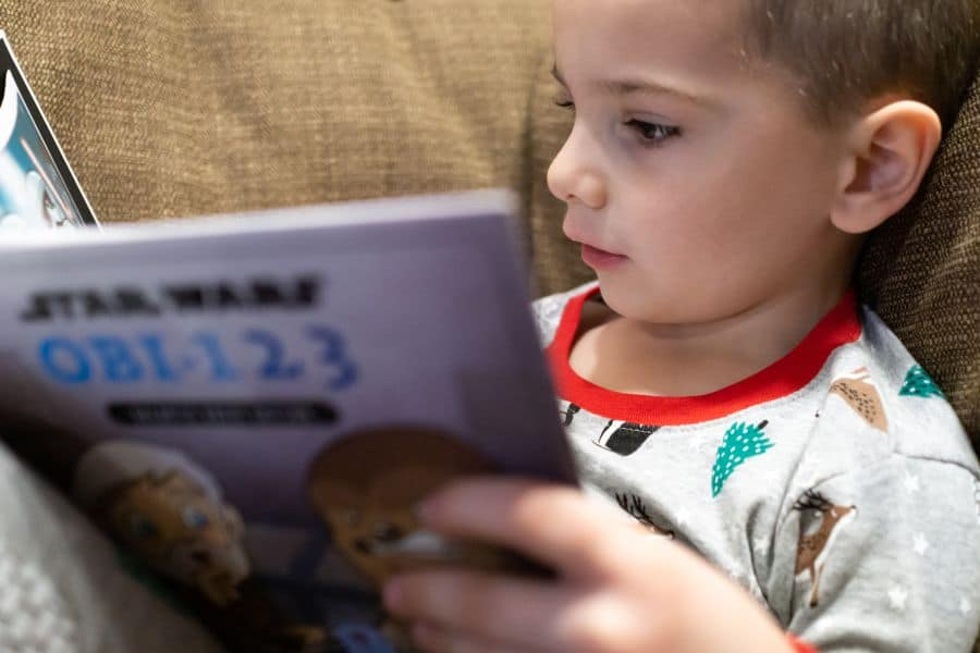 Young Boy Reading a Star Wars Math Counting Book