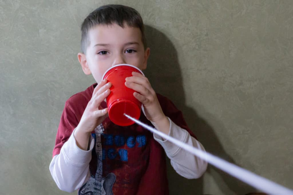 Talking into a plastic cup phone