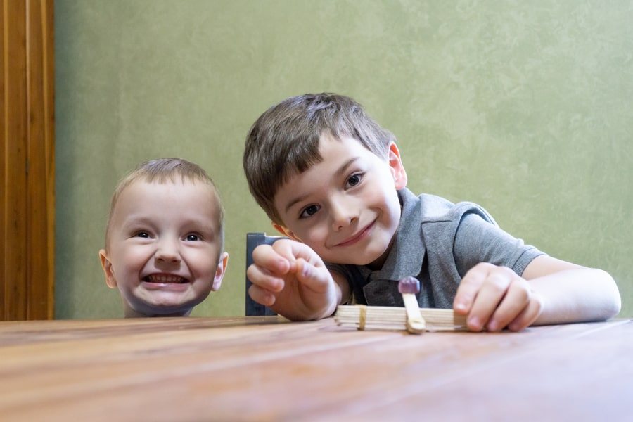 Kids Ready to Launch a Popsicle Stick Catapult