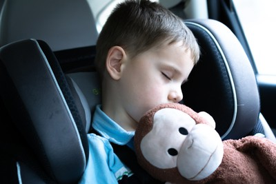 child with stuffed monkey curious george